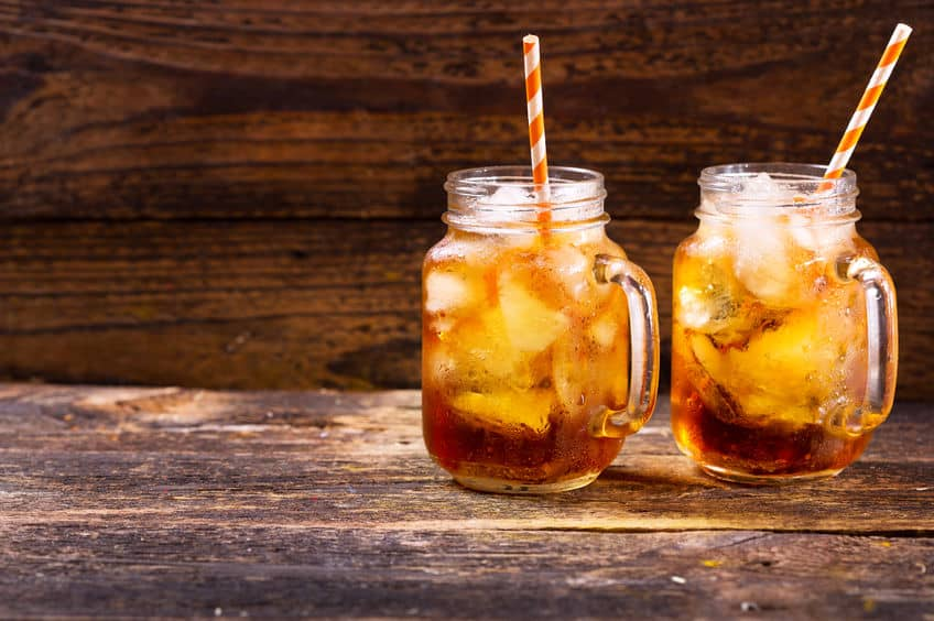 Two jars of perfect, refreshing ice tea sitting on a wood table