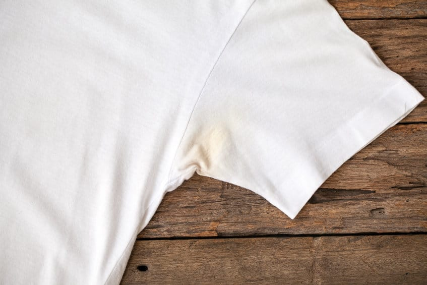 yellow armpit stains on white t shirt