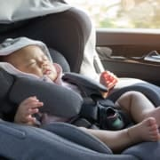 Baby sound asleep in a car seat