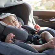 A baby sitting in a car