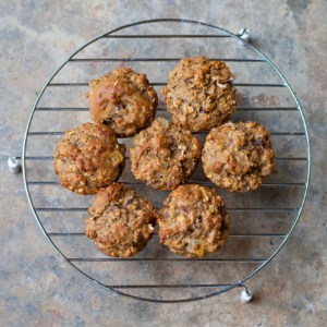 Freshly baked bran muffins cooling on a rack
