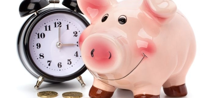 alarm clock coins and piggy bank on white background.