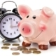 A close up of a piggy bank and a clock
