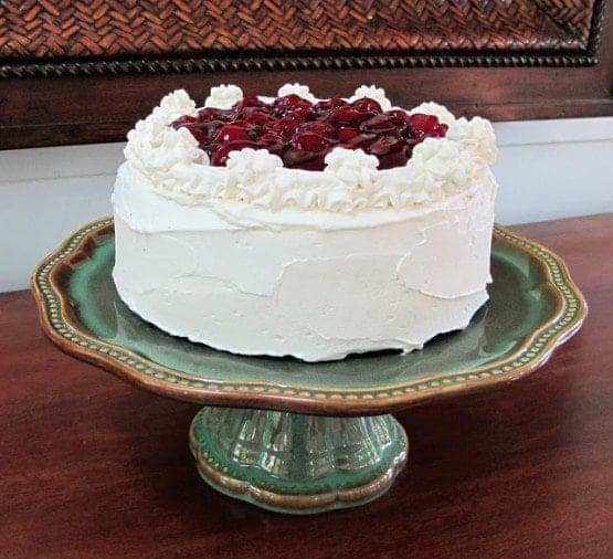 Cake with icing and cherries