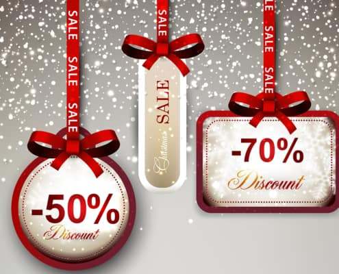 Set of sale and discount paper labels with red bows and ribbons.