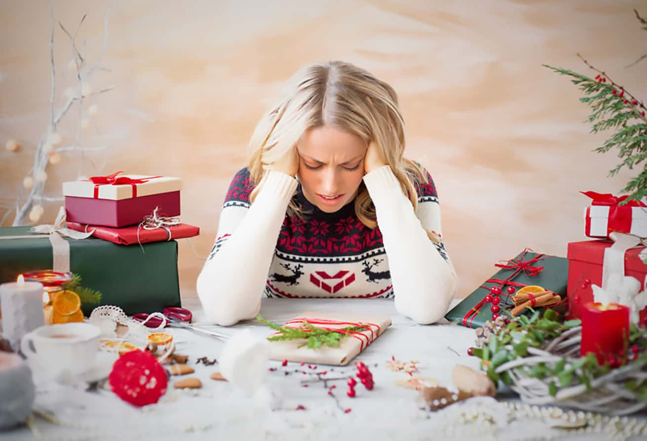 woman stressed out over Christmas debt