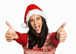 Woman giving a thumbs up on no christmas credit card debt white background
