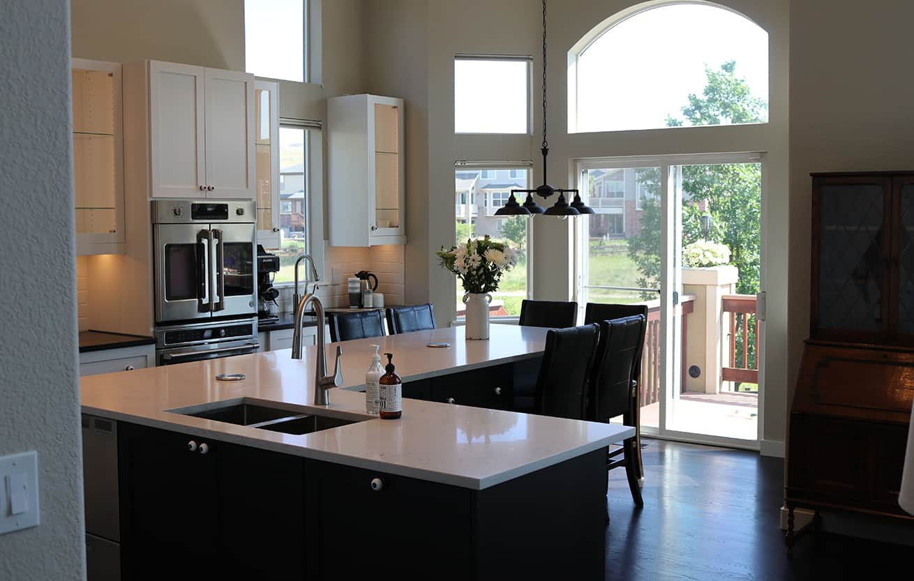 clean kitchen with island in foreground