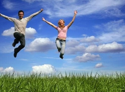 Couple-Jumping with Joy above their circumstances