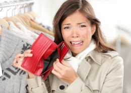 empty wallet - woman with no money in purse shopping. Female