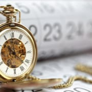 Pocket watch against a calendar concept for planning for best time to bag a bargain