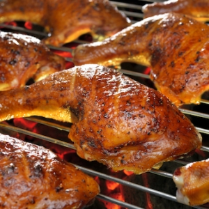 A close up of food on a grill, with Chicken