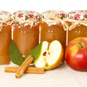Tasty home canning caramel apple jam in glass jars.