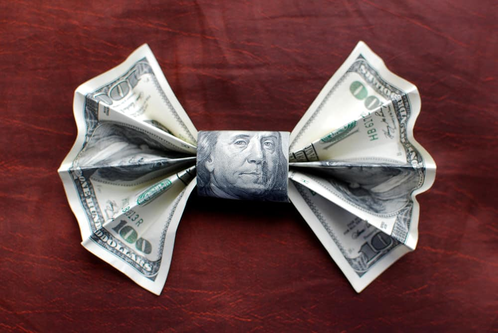 100 dollar bill folded into a bow tie