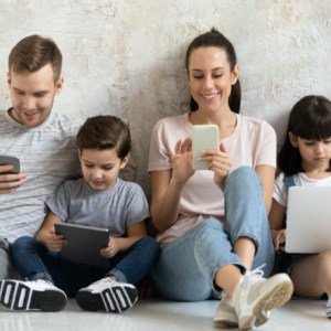 family using mobile devices