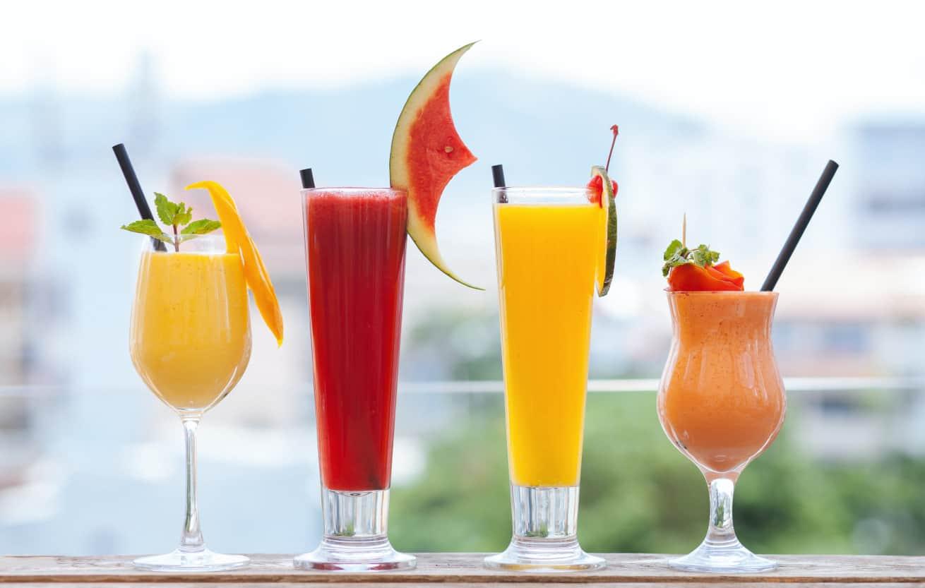 summer frozen drinks in fancy glassware