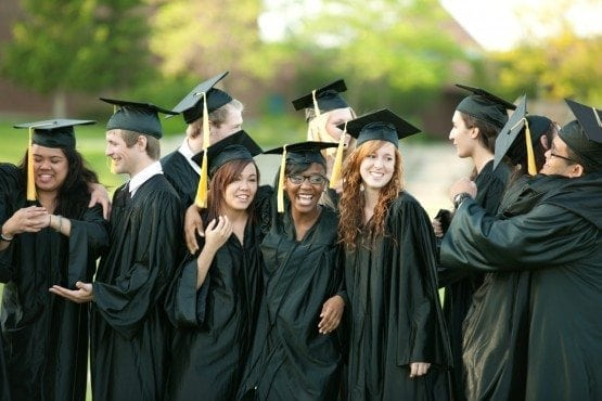 A diverse group of young adult graduates