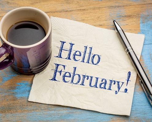 A cup of coffee on a table, with February