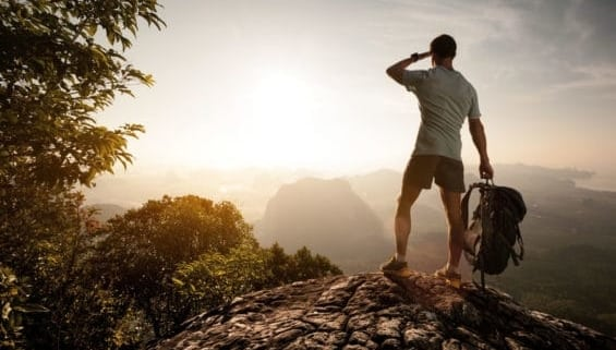A man standing on top of a hill