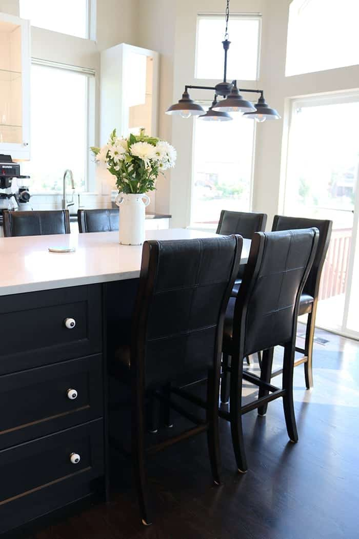A kitchen with a leather chair