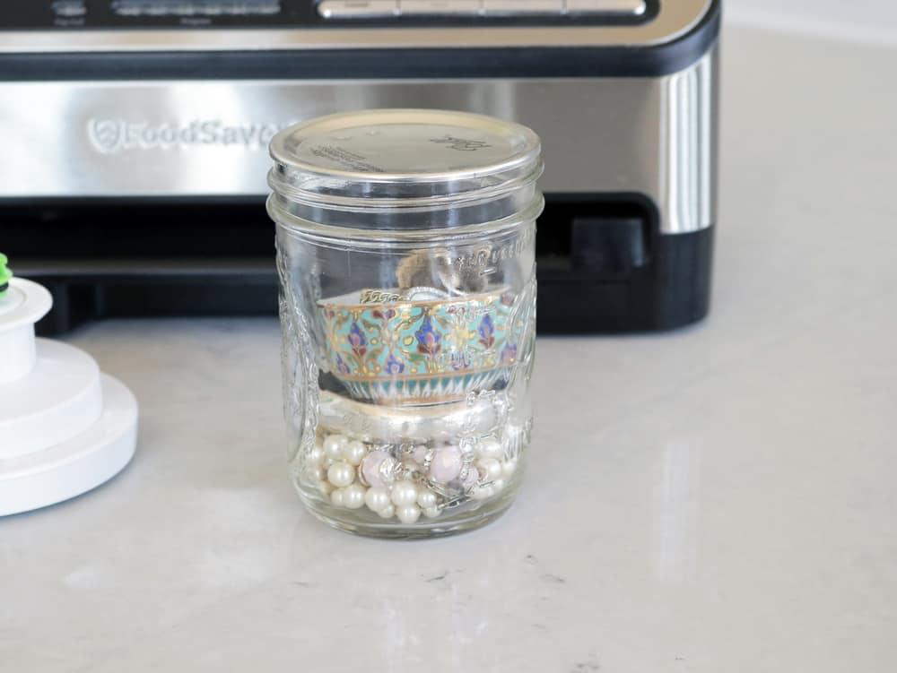 Mason jar vacuum sealed with precious jewelry inside to prevent tarnishing