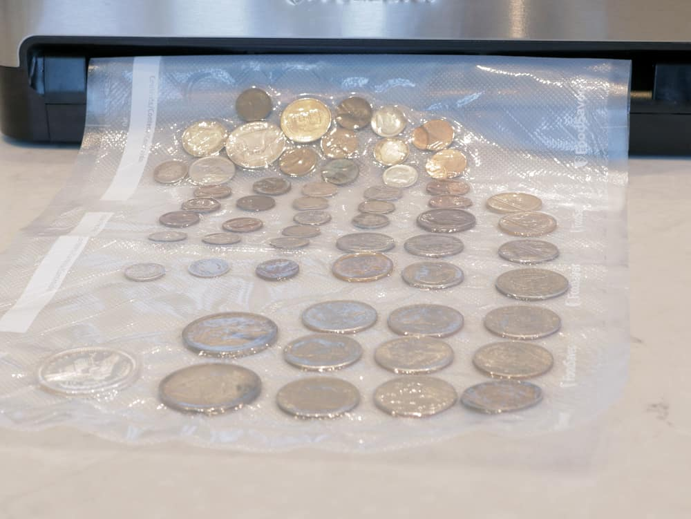 Collectible coins protected and sealed in FoodSaver bag