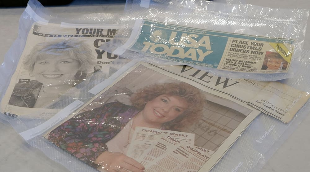 Newspaper clippings vacuum sealed for protection and longevity
