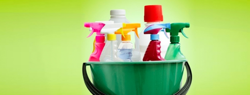 spray bottles in a bucket filled with cleaners you can make yourself that better than store bought and lots cheaper too