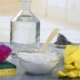 Homemade green cleaning, Eco-friendly natural cleaners with baking soda rubber gloves sponge and carafe of white vinegar