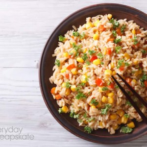 A bowl of food with rice and vegetables, with Fried rice