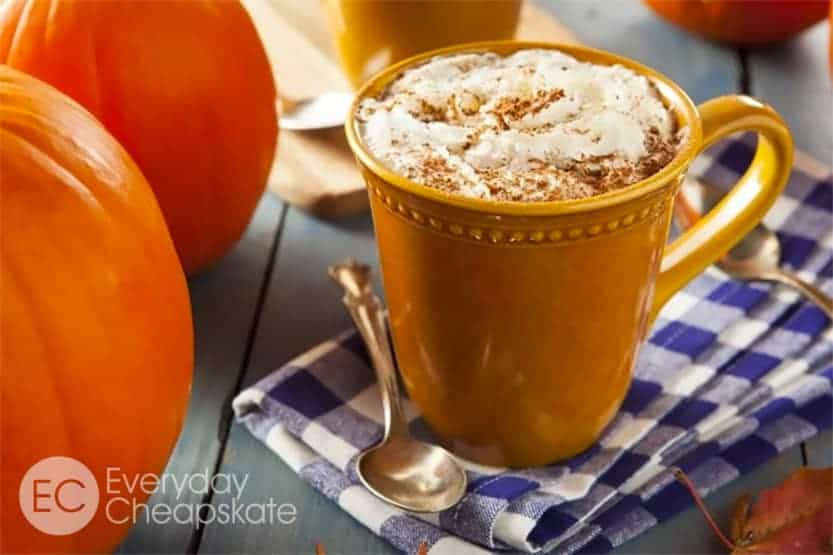 A cup of coffee and a glass of orange juice, with Pumpkin and Spice
