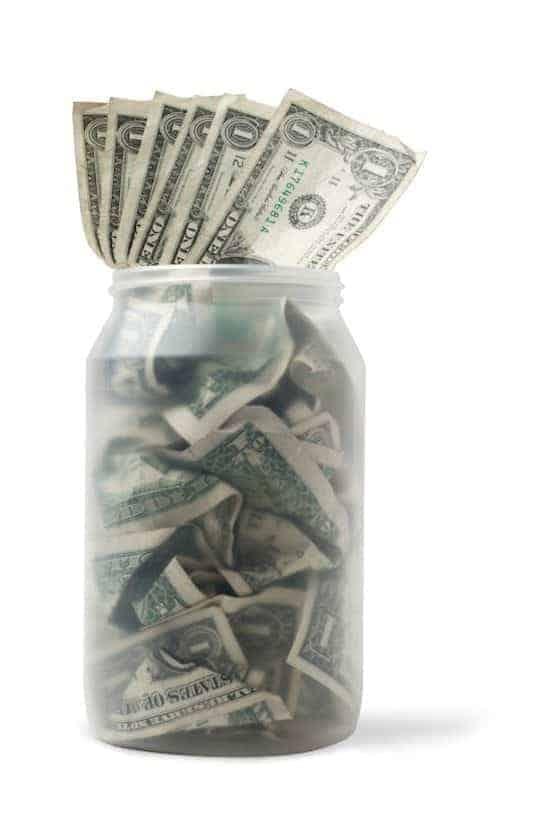 Plastic jar with dollar bills