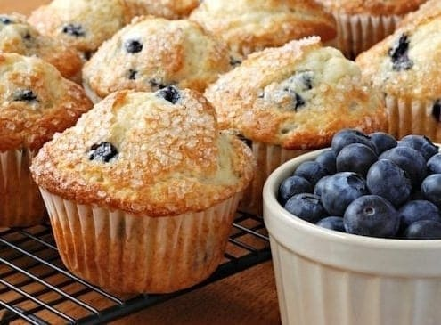 Food on a table, with Blueberry and Muffin