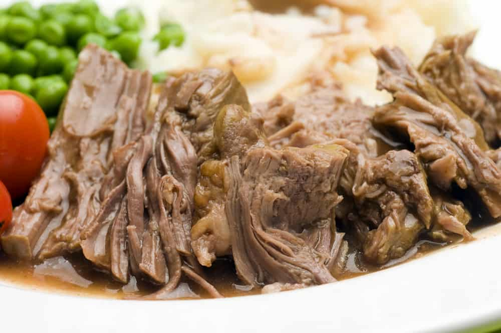 sliced pot roast dinner with mashed potatoes