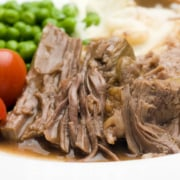 A close up of a plate of food, with Pot roast