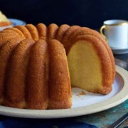 A close up of a plate of food and a cup of coffee, with Bundt cake
