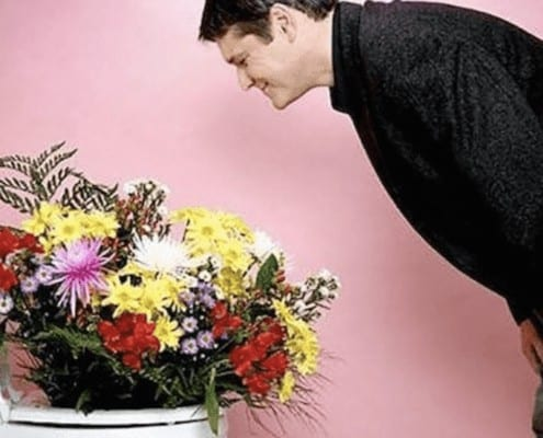 man-leaving-bouquet-of-flowers-in-toilet