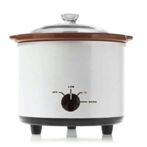 vintage white slow cooker on white background