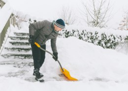a-man-shovelling-snow-in-winter-