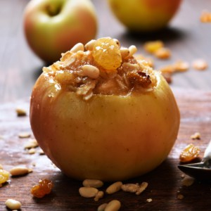 Baked apple stuffed with granola and nuts