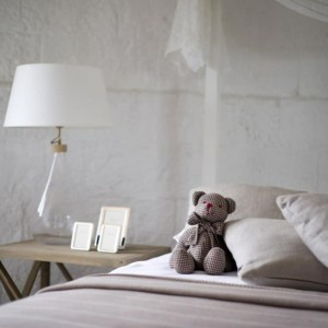 A teddy bear sitting on top of a bed