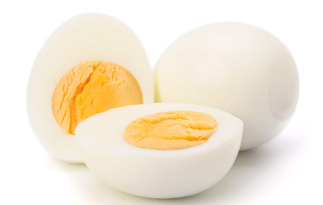 Shelled boiled egg isolated on white background