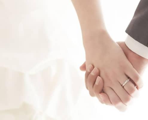 bride_groom_holding-hands