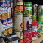 cans of non perishable food on a shelf