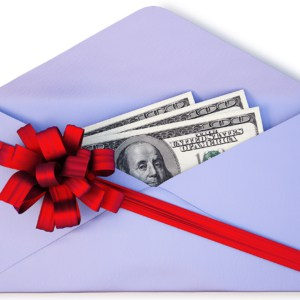 open a paper envelope with the dollars tied with red ribbon and bow.