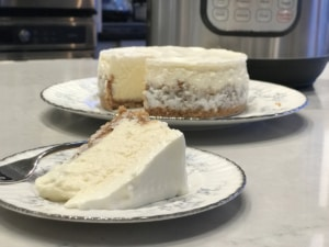 A slice of cake on a plate, with Cheesecake