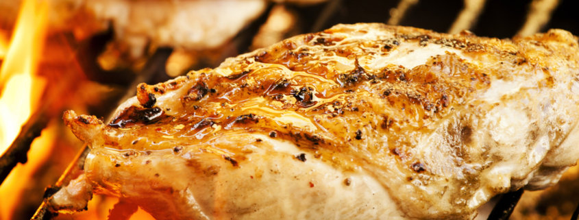 A close up of food on a grill, with Chicken breast