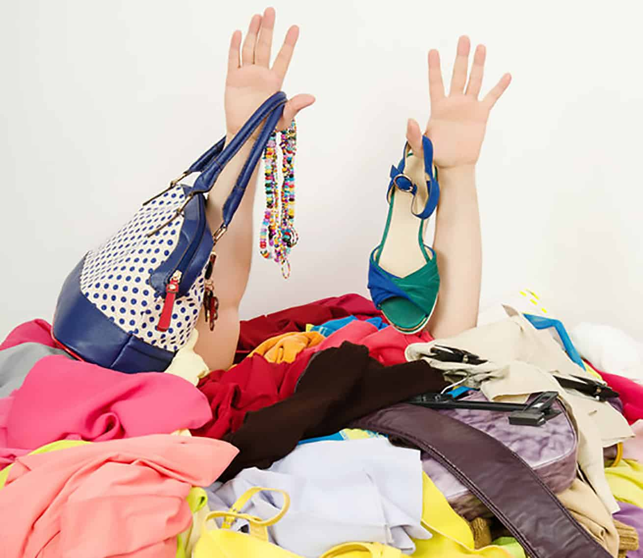 woman buried in closet clutter