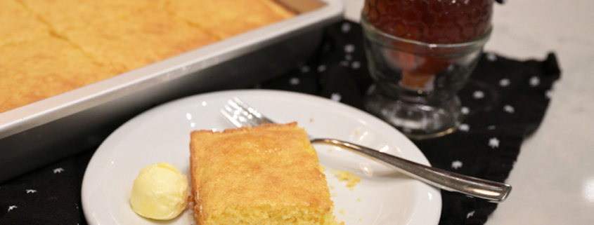 A plate of food on a table, with Cornbread