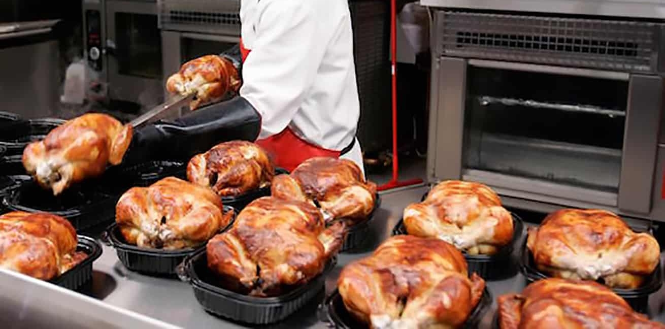 rack of Costco rotisserie chickens